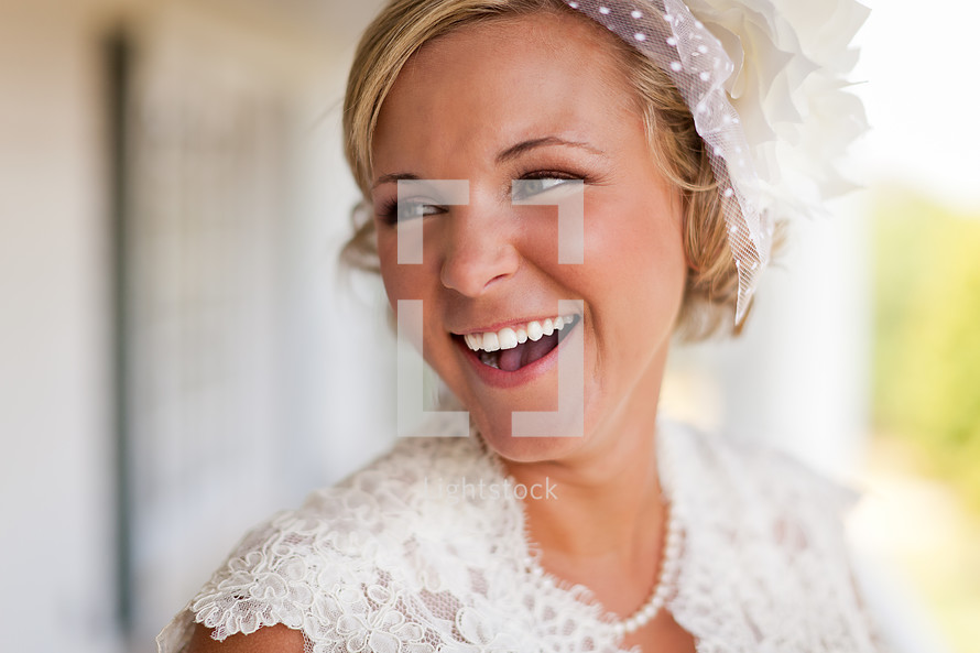 Bride smiling with veil