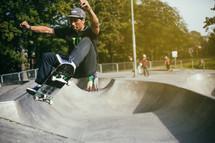 a man on a skateboard at a skatepark