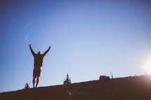 man reaching to top