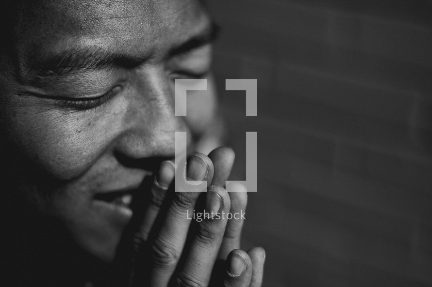 A man smiling in prayer