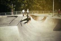a man doing tricks on his skateboard in a skatepark