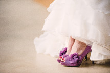 bride with fuchsia high heel shoes
