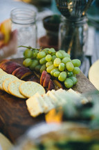 cheese and cracker plate and grapes