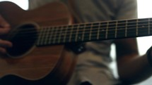 guitarist strumming a guitar