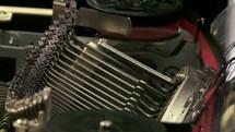 Typing on a typewriter.