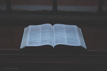 open Bible in a window sill