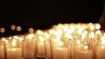 Glowing prayer candles.