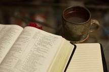 coffee mug, Bible, and journal