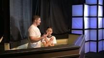 man baptizing a child