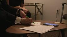 taking notes at a meeting