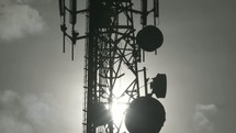 clouds moving and satellites on a communication tower