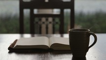 open Bible and coffee