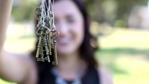 woman holding skeleton keys