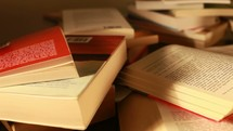pile of books (tracking motion)