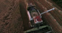 combine plowing over a field