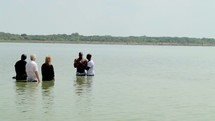 Baptism at the lake.