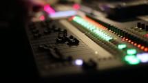 blinking lights on a soundboard