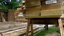 man picking out lumber