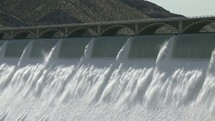Water rushing through a dam.