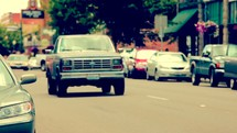 cars driving down a street