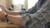 man using his iPad