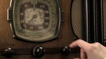 Tuning a vintage radio.