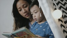 a mother reading to her son