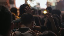 youth praying at a youth rally