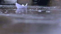 Paper boat floating in water.