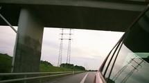 car driving down a road