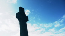 Silhouette of St. Martin's cross at Iona Abbey.