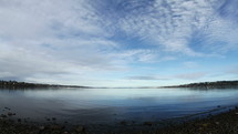 Timelapse of cloud and water movement at a lake.