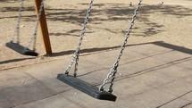 empty swinging swing
