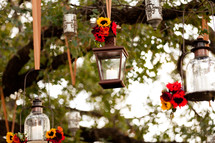 Candle lanterns hanging in a tree
