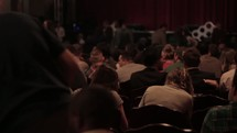 Audience taking their seats before a show.