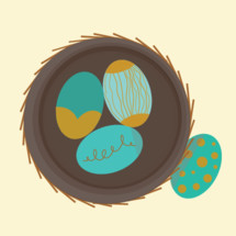 teal and gold eggs in a nest