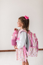 girl with a lunchbox and book bag