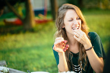 a woman eating grapes