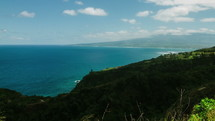 ocean water and green sea cliffs