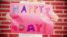 12 clips of a young girl making a Mother's Day Card