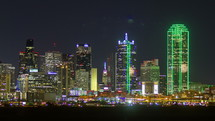 Timelapse of downtown traffic at night near the Dallas skyline.