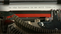 "Typewriter typing ""He who believe in me shall live."""
