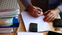 calculation and frustration paying bills