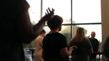hands raised in worship and praise during a worship service