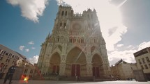Timelapse of traffic in front of Amiens Cathedral in France.
