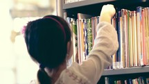 Girl perusing the library.