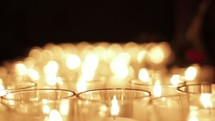 Flickering prayer candles.