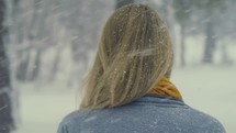 woman walking outdoors during a snowfall