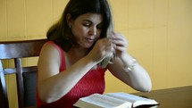 Woman reading the Bible and praying.