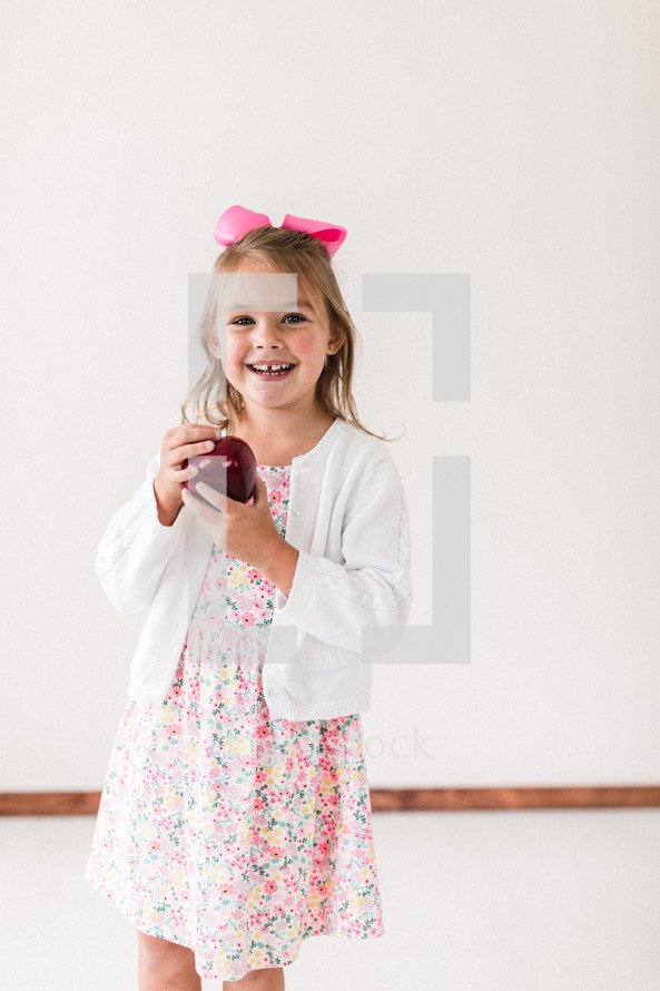 child holding an apple